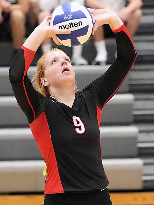 Cyclone senior Kara Weis, who finished with 28 assists, sets up an HCHS attack. (Photos by Mike Oeffner)