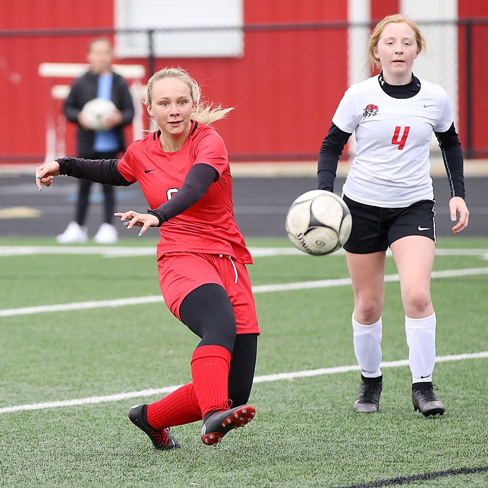 HCHS junior Raegen Wicks scores one of her four goals in front of Greene County's Graci Cooklin (4) during Monday's match at Merrill Field. Wicks added three assists to her second straight four-goal match as the Cyclone girls rolled to an 8-0 win. (Photos by Mike Oeffner)