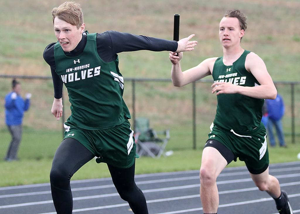 IKM-Manning's Raine Meneough (right) hands off to Will Jorgensen in the distance medley relay. The Wolves placed fourth in the event but did win two other conference meet relays.