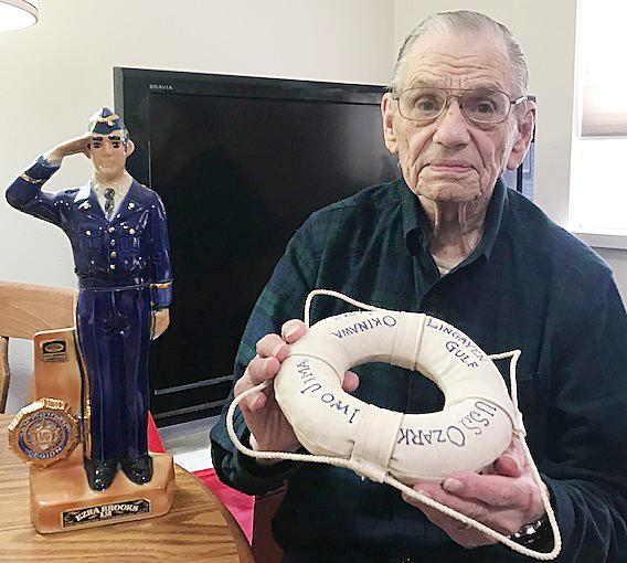 Heller shows a life preserver that has some of the places he was at during the war listed on it.  A fellow serviceman on the ship made them for his ship mates.