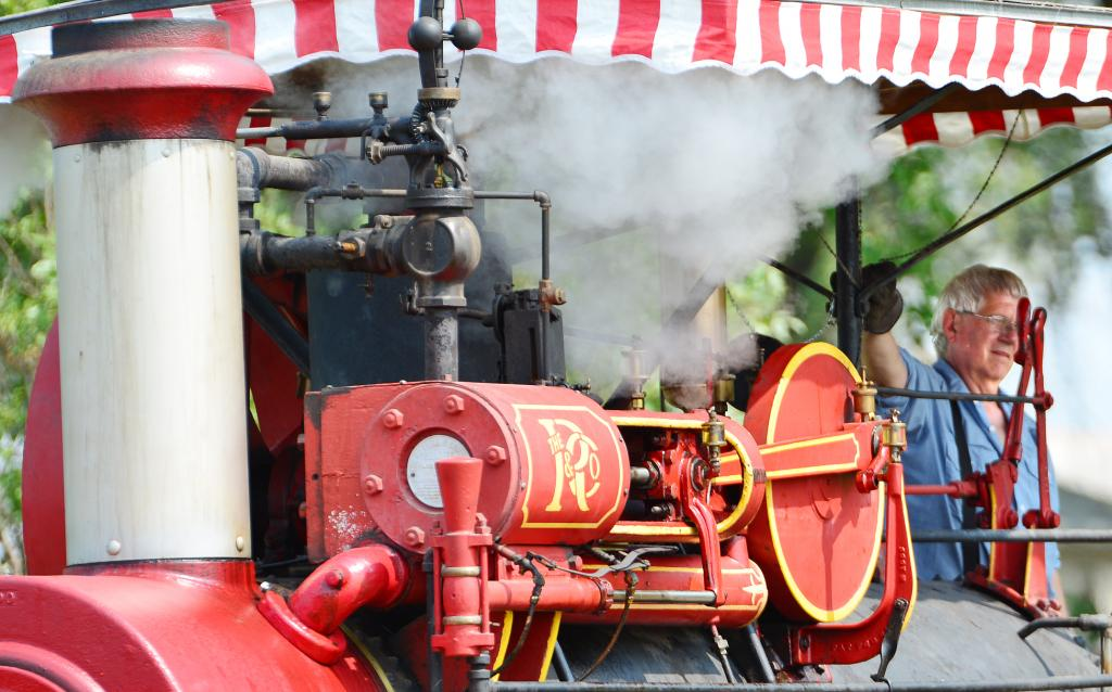 Dennis Sawyer blows the whistle on the steam engine to tell the kids it's time to move from station to station.