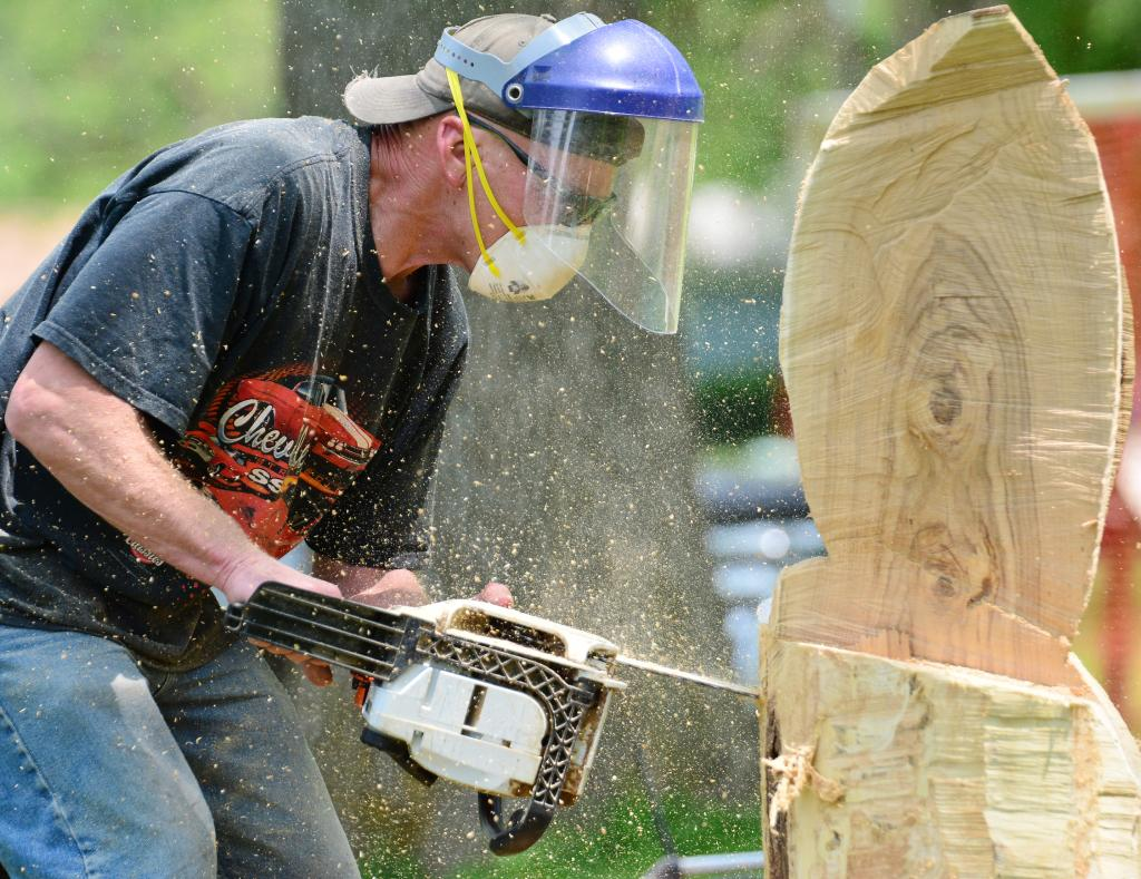 Chainsaw artist Scott Pries works on one of his works of art.