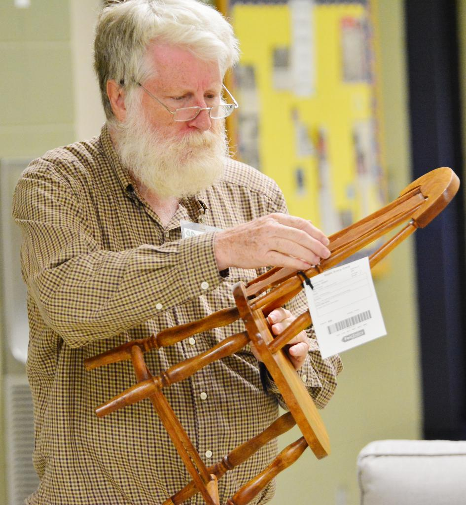 Judging the woodworking entries at Immanuel Lutheran Church last week was Rich Pope.