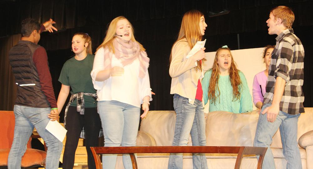 Putting the finishing touches on the winter play recently were top L to R -- Camron Buck, Maggie Nollen, Katelyn Kluver, Macey Bendorf, Maya Kenkel, Emma Hilario, and Tim Mumm.