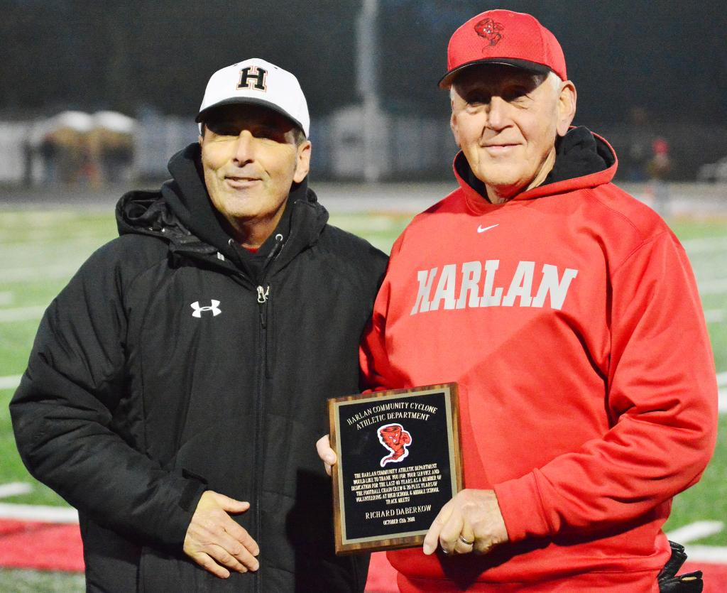 Presenting Richard Daberkow (right) with the plaque is HCHS Athletic Director Mitch Osborn. Daberkow was presented the honor before the HCHS/Creston-OM football game.