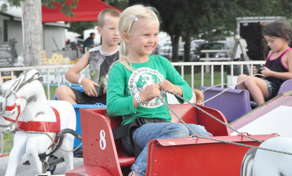 Kamryn Scheve enjoys one of the carnival rides at the Shelby County Fair in July.