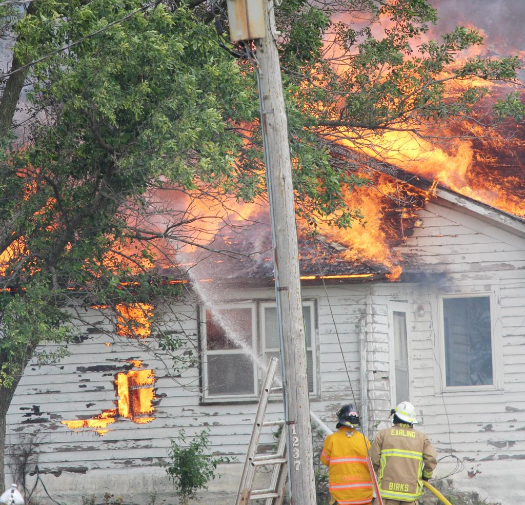 Firefighters work to keep the blaze from spreading.