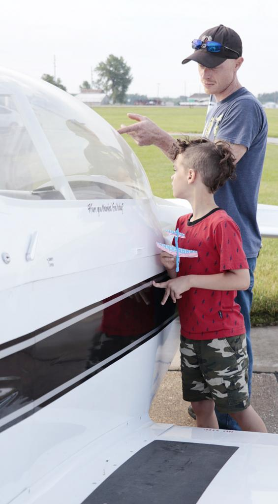 Waylon Lee and his dad, Remington Lee, view the airplanes together.