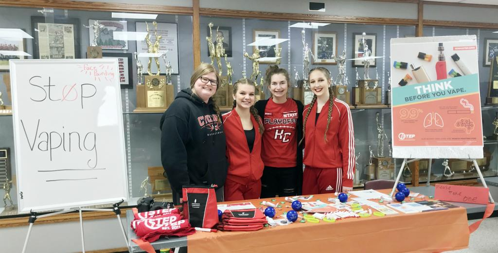 Harlan HOSA students with their Stop Vaping booth at Red Out this year include L to R -- Kayla Powers, Rachel Anderson, Ashley Sonderman and Justina Borgman.