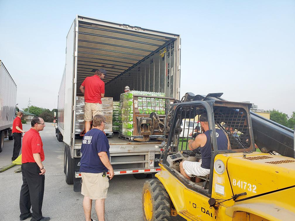 Fire departments in Shelby County unloaded water, courtesy of Hy-Vee, on Friday for Shelby County community residents affected by the water shortage due to the fire at a Regional Water Rural Water Association pump station.  Fareway also donated water for area residents.