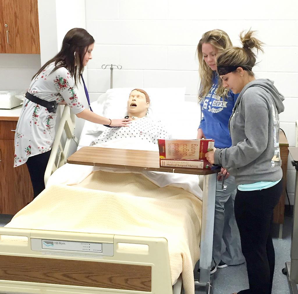 Nursing students Stephanie Schmitz, Dana Tanner and Sarah Oliver work on an assignment.  IWCC enrollment has increased this year.
