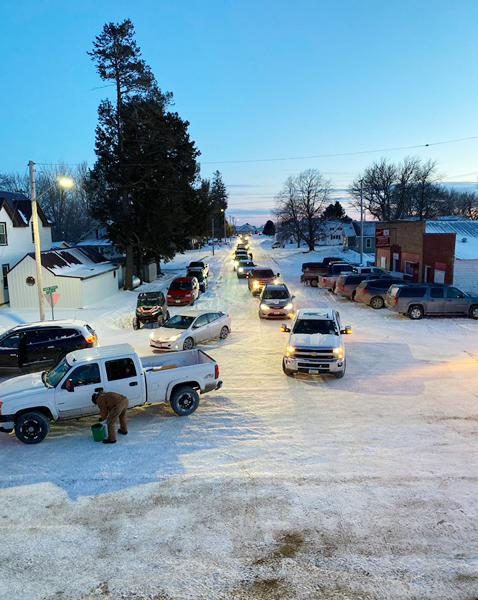 Cars lined up in Westphalia to get their drive-through meal, courtesy of the Cattlemen's Association.