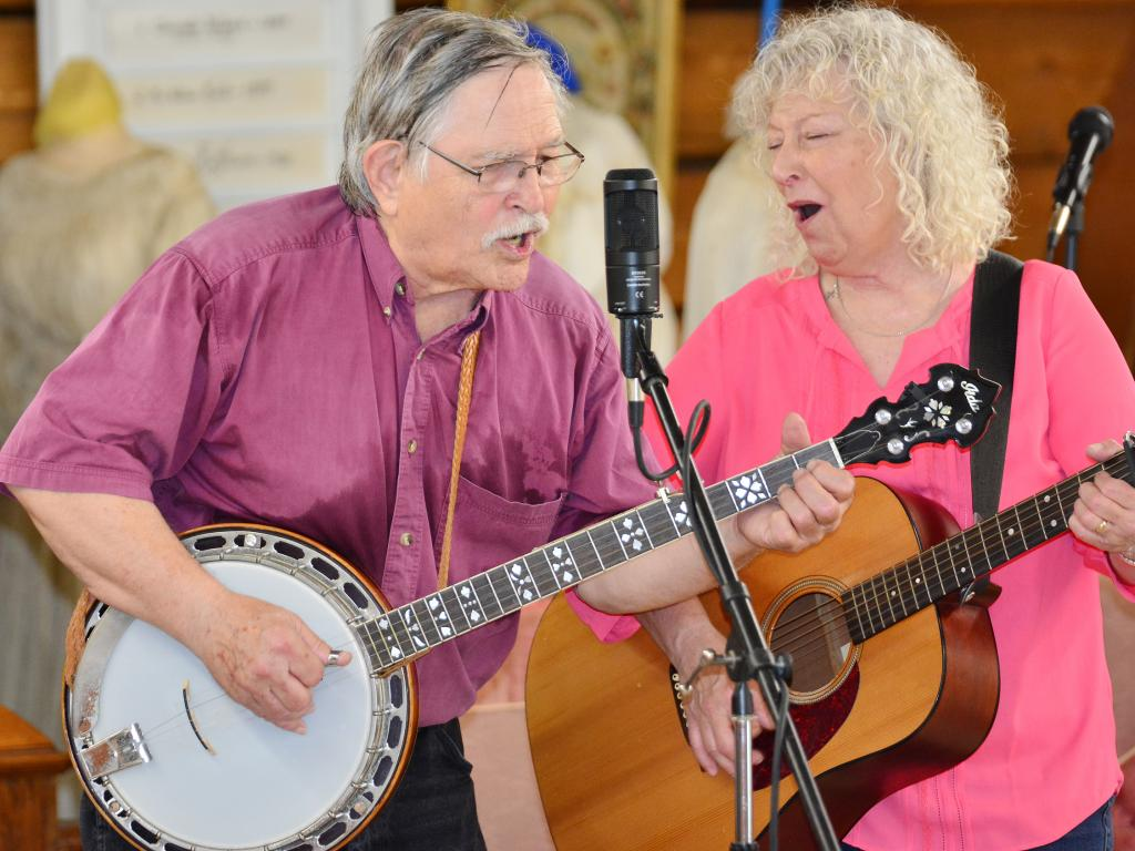 Singers Bob and Kristie Black perform during the festivities at Log Cabin Day.