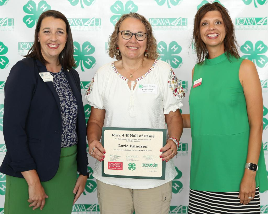 The 2021 Iowa 4-H Hall of Fame Ceremony was held on Sunday, August 22 at the Iowa State Fair. Pictured with Lorie Knudsen, Shelby County's inductee, are Emily Saveraid, left, Executive Director, Iowa 4-H Foundation and Tillie Good, right, Staff and Volunteer Development Manager, Iowa 4-H.  (Photo contributed)
