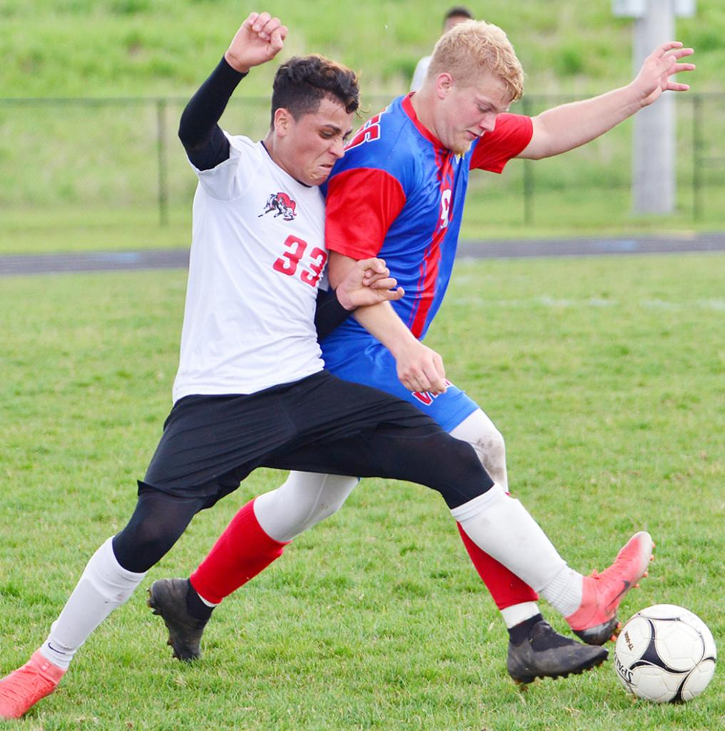 AHSTW senior Gabe Madsen (right) battles Greene County's Maynor Carballo for the ball during Saturday's substate final.