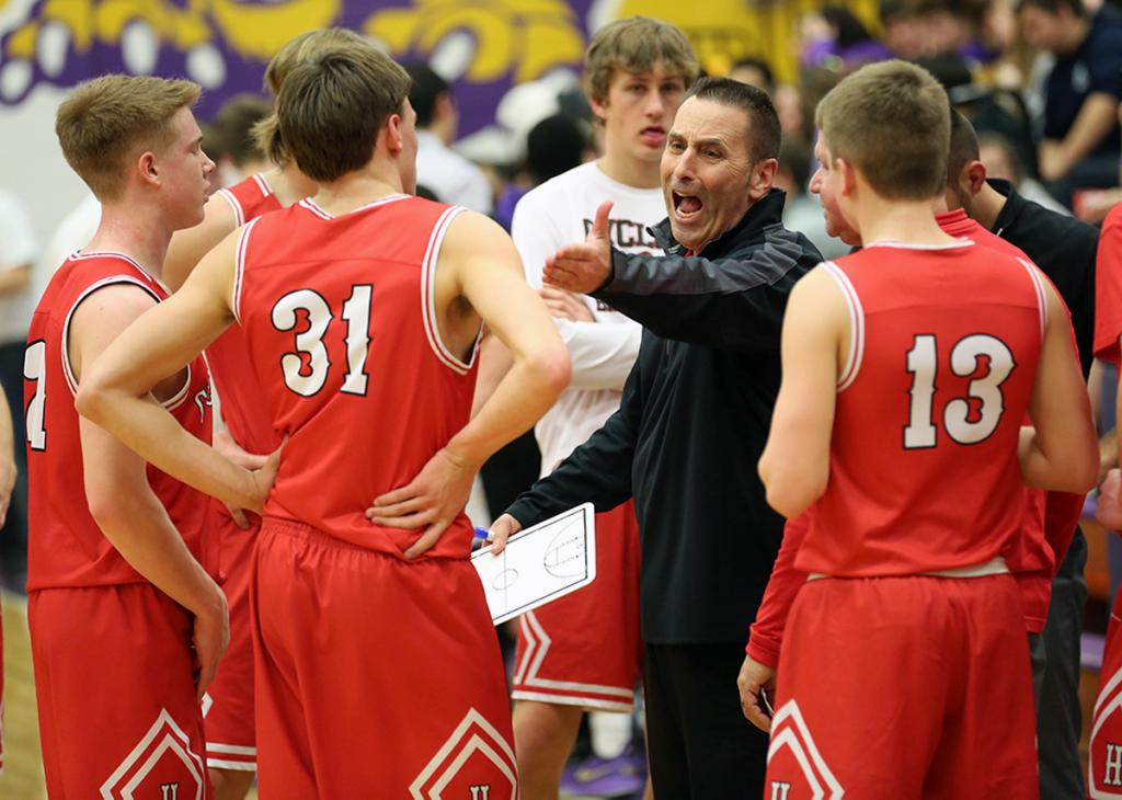 HCHS coach Mitch Osborn talks to the team during a timeout at Denison. Cyclone players include Brad Curren (13), Michael Heithoff (31) and Michael Erlemeier (left). (Photo courtesy of Todd Danner, Denison Bulletin/Review)