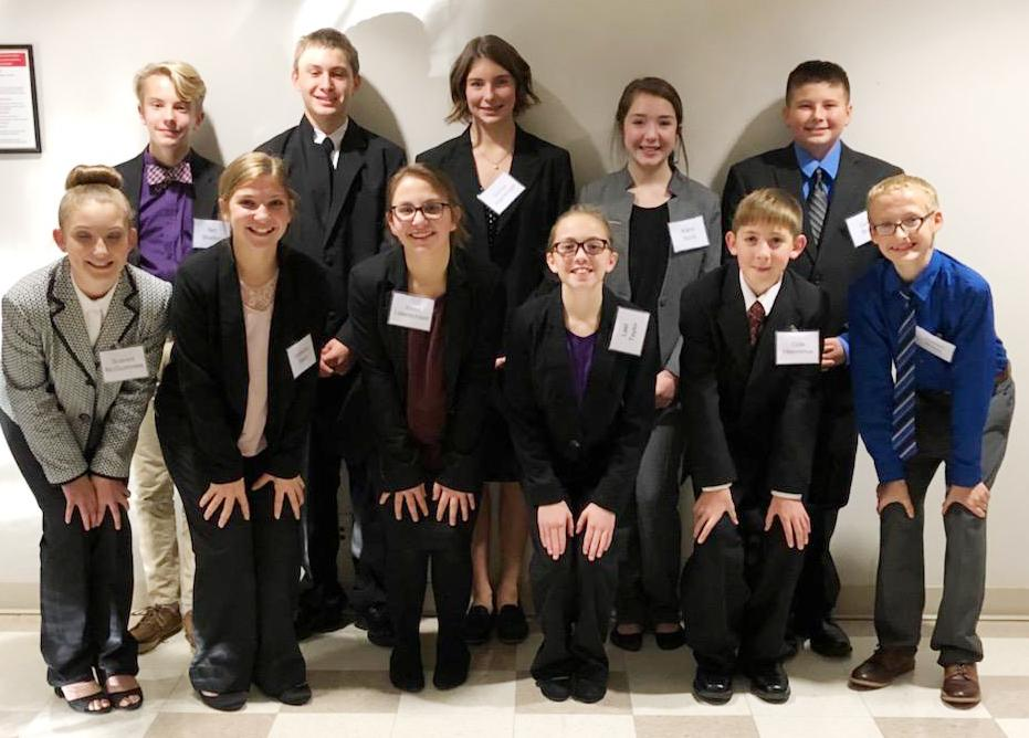 The seventh grade team includes front L to R -- Scarlett McGuinness, Isabelle Gaul, Violet Lotenschtein, Lael Taylor, Cole Heronimus and Joseph Bragg.  Back L to R -- Ian Shelton, Noah Schmitz, Darbie Argotsinger, Kami Stork and Gavin Bruck.
