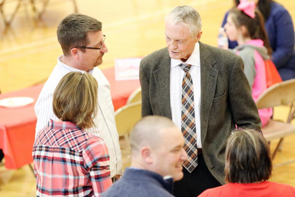 Tom Osborne visits with community members ahead of his speech, including Shelby County State Bank President Kevin Campbell.