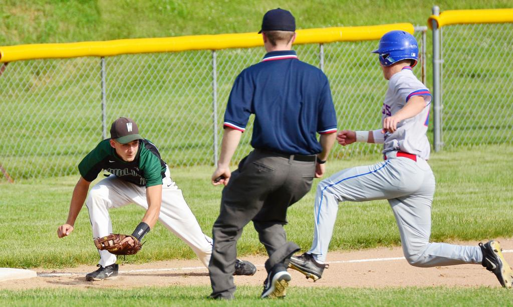 IKM-Manning's Alex Lingle (left) prepares to tag out an AHSTW runner at third base.
