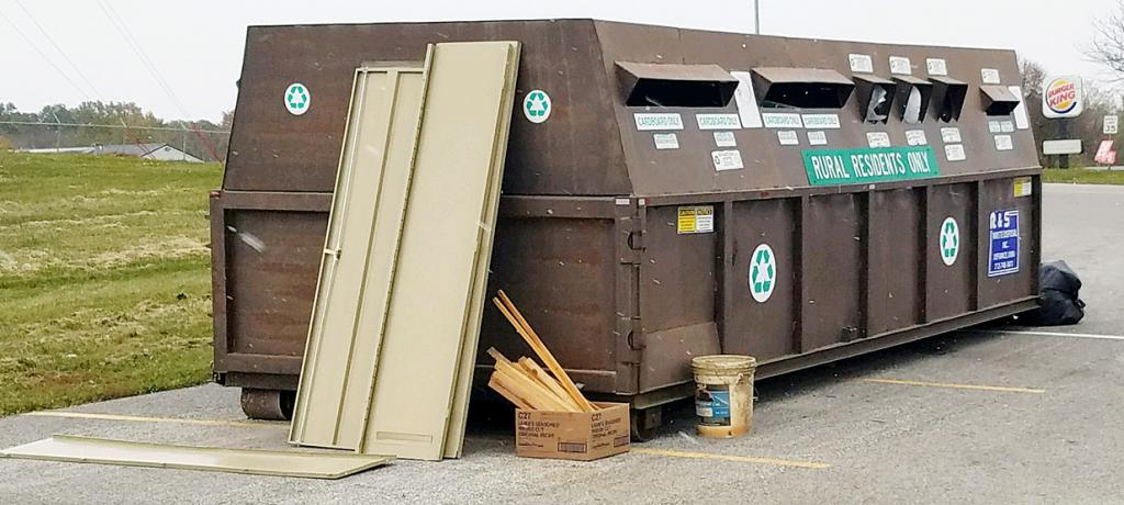 Just this week residents left this garbage outside the recycling bin in the former Shopko parking lot.  Officials are asking residents to stop putting garbage at this site as it's only a recycling bin for rural residents.  (Photo contributed)