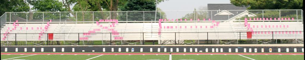 The word 'Hope' is spelled with pink luminary bags, with a cancer awareness ribbon instead of an 'O'.
