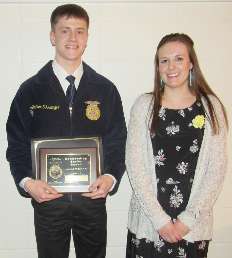 Andrew Schechinger receives the DEKALB Agricultural Accomplishment Award from instructor Justine McCall.