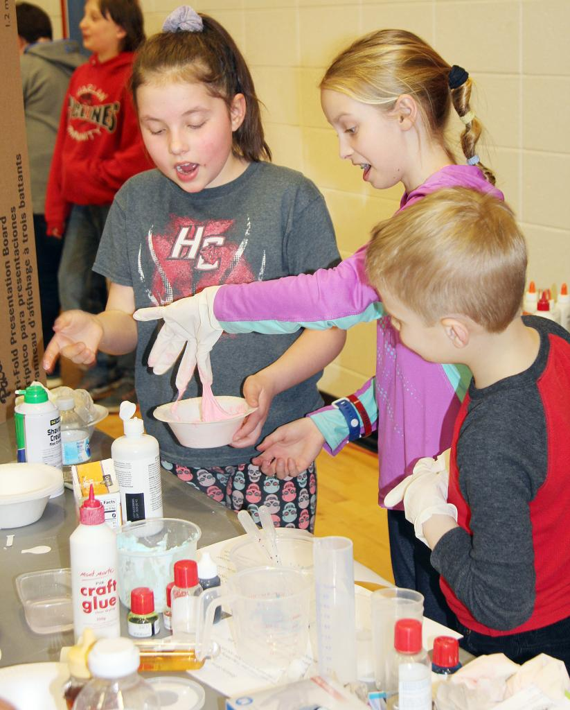 Making slime at Mrs. Vanden Berg's booth at the event were from left: Judy Coenen, Anastacia Kay and Daniel Kay.