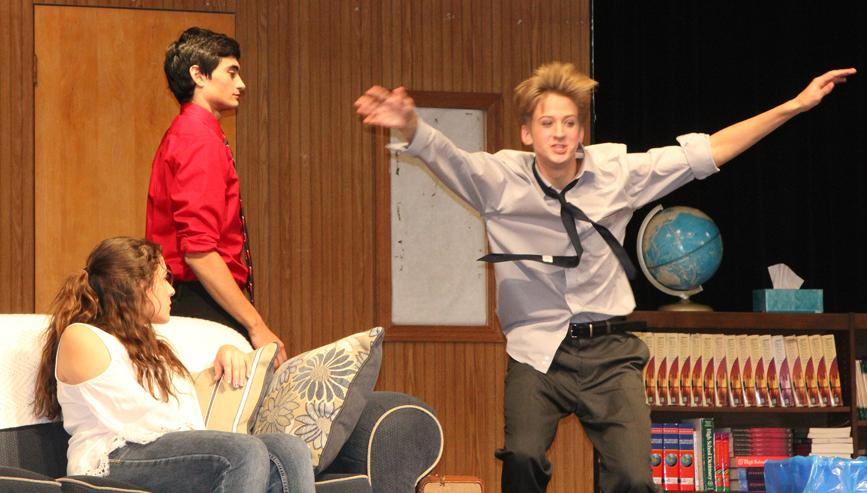 Emma Hilario, Brandon Trevino and Andrew Shelton (l to r) practice this week for the Who's Crazy Now? production this weekend at HCHS.  (Photo by Kim Wegener)