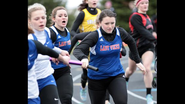 AHSTW's Lexy Knop starts the second leg of the Lady Vikes' second-place 4x100 relay after taking the baton from Konner Knop at the Audubon Early Bird Invite on Monday.