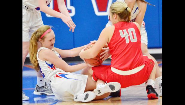 Lady Vike sophomore Claire Harris (left) battles Sydni Huisman for a loose ball during Tuesday's WIC matchup.