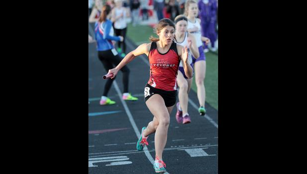 Alyssa Sotelo starts the anchor leg of the HCHS 4x400 relay on Thursday night at Merrill Field. The Cyclones placed third behind Bishop Heelan and Denison.