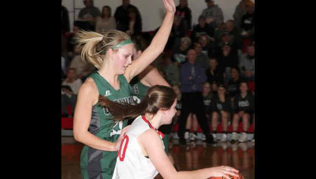 IKM-Manning's Alexa Ahrenholtz (left) guards Audubon's Leah Subbert during Tuesday's Western Iowa Conference game.