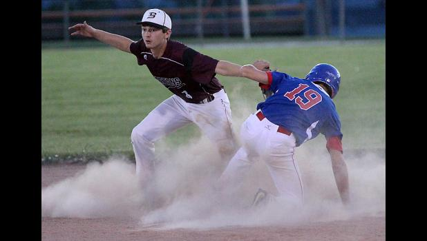 Spartan shortstop Alex Amaral tags out Alex Caskey of Earlham attempting to steal second base.