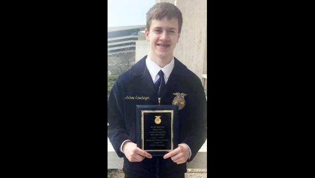 Andrew Schechinger receiving his plaque for a 1st place proficiency award in Poultry Production. This qualified him for the national competition.