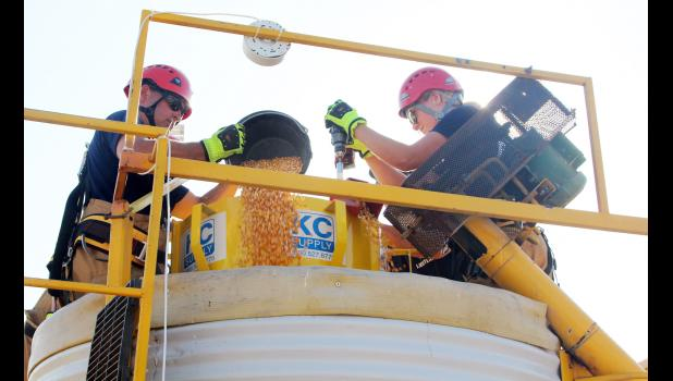 Patrick Gaul (left) and Madison Doonan demonstrate a grain bin extrication exercise.  (Photo by Kim Wegener)