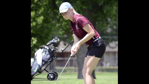 Exira-EHK sophomore Jacey Anthofer putts the ball during last week's Class 1A Girls State Golf Tournament. Anthofer placed 12th in her state meet debut, shooting two rounds of 88. (Photo courtesy of Nate Tenopir, Atlantic News-Telegraph)