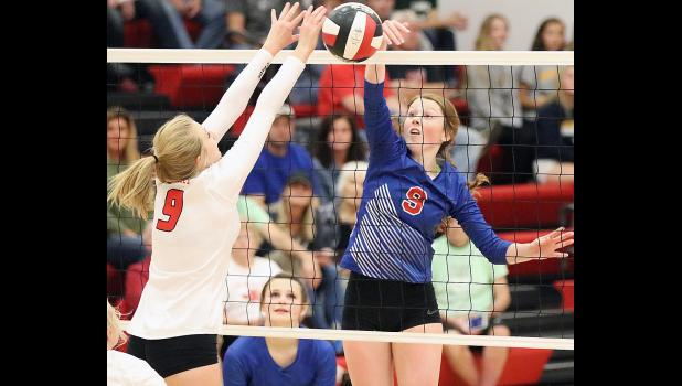 AHSTW senior Katie Anzalone (right) wins a battle at the net with Treynor's Kayla Chapman during Monday's regional match. Anzalone led her team with nine kills and two blocks but the Cardinals advanced with a 3-0 sweep. (Photos by Mike Oeffner)