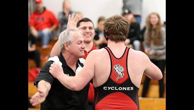 HCHS senior Joey Arkfeld (right) is congratulated by head coach John Murtaugh and assistant coach Matt Hoch after pinning Sergeant Bluff-Luton's Dustin Stowe in a 220-pound wrestle-back match for second place at Saturday's 2A Sectional Tournament. Arkfeld's pin not only secured a district qualifier spot for himself, but also lifted the Cyclones to second place in the team standings to earn a berth in the regional duals.