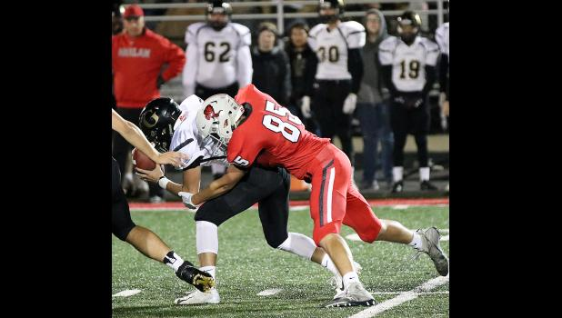 Cyclone senior Brady Wagner (85) makes one of his nine tackles against Glenwood. Wagner had four tackles for loss, including two and a half sacks.