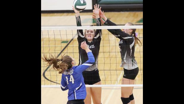 IKM-Manning's Caitlin Muhlbauer (center) and Gabby Cadwell block an attack by Underwood's Megan Freese during Thursday's 3-1 Eagles victory.