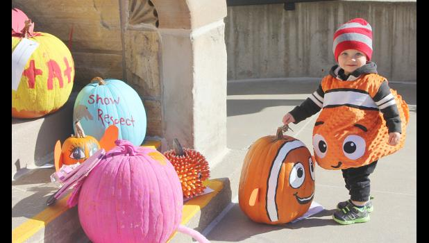 Carter Wilkerson, the son of Bonnie and Adam Wilkerson, Elkhorn, NE, dressed up as Nemo, and matched one of the pumpkins submitted in the pumpkin decorating contest by HCS Teacher Carolyn Kiesel's first-graders.