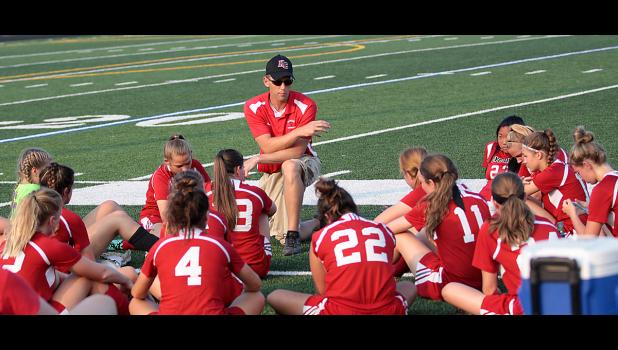 Cyclone coach Jared Boysen talks to the team at halftime of Friday's 4-0 regional semifinal loss to the Lions.