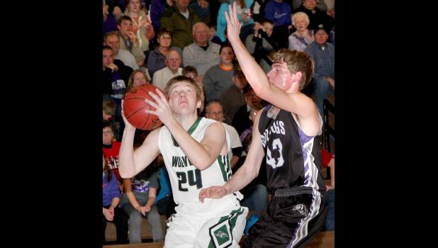 IKM-Manning sophomore Colten Brandt (24) looks to score against Boyer Valley during last Tuesday's district semifinal. (Photo by Kim Wegener)