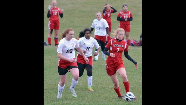 HCHS senior Jenna Brelje (7) controls the ball for the Cyclones.