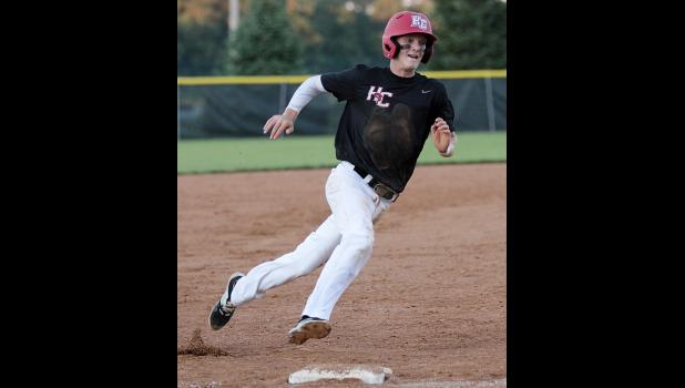 Cyclone sophomore Connor Bruck rounds third base to score a run. (Photos by Mike Oeffner)