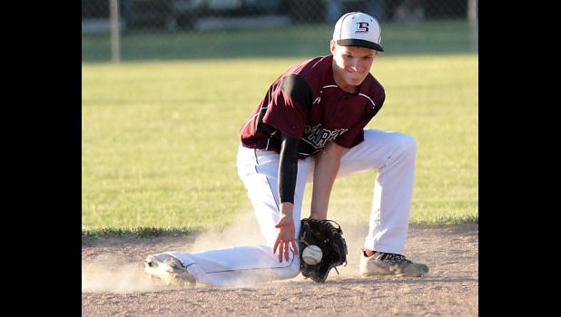 Spartan sophomore Cole Burmeister fields a ground ball near second base. (Photos by Mike Oeffner)