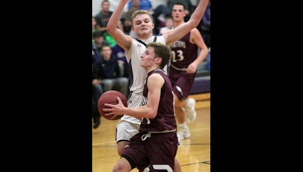 Exira-EHK's Cole Burmeister drives to the basket on Boyer Valley's Joe Weber.