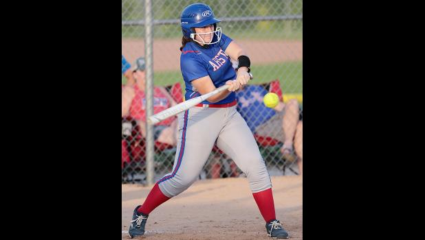 AHSTW senior Sarah Butcher puts the ball in play against Underwood during the July 3 regional game.