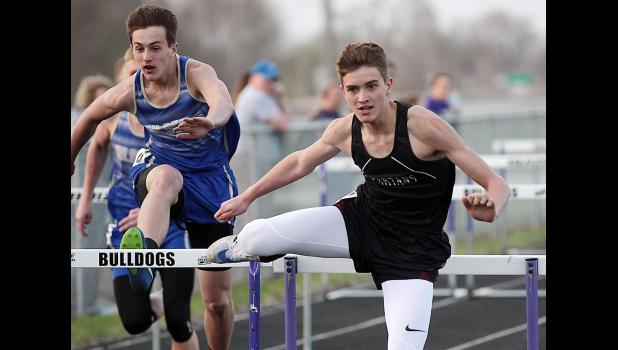 Exira-EHK's Creighton Nelson (right) placed in all four of his events during Monday's Rolling Valley Conference Meet, including this fourth-place effort in the 110-meter hurdles.