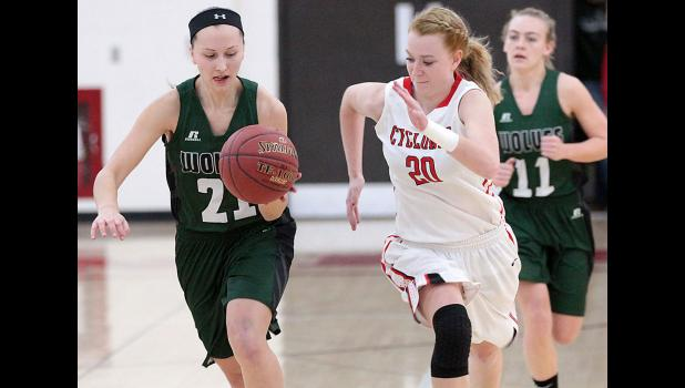 HCHS senior Lexi Larsen (20) chases after IKM-M's Gabrielle Cadwell in transition.